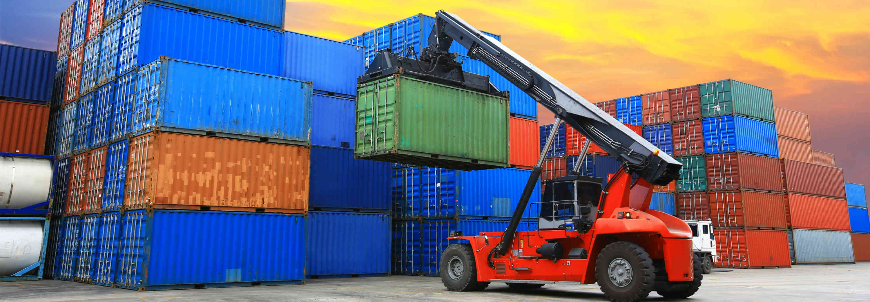 intermodal container lifted on top of other containers